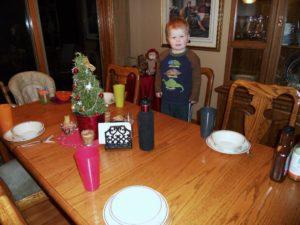 Eli setting the table