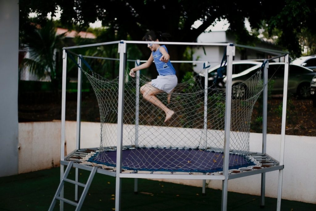 The trampoline provides calming, rhythmic movement.